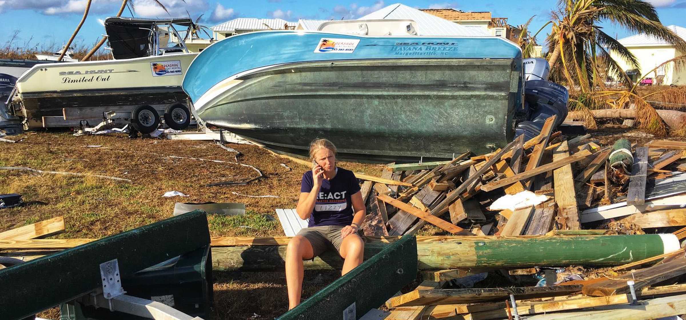 Lizzy with overturned boat in background.jpg